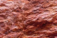 Rote Felsenoberfläche für Beschaffenheitshintergrund lizenzfreies stockfoto