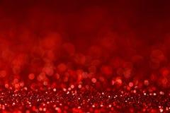 Rote Funkelnbeschaffenheit der Nahaufnahme mit Unschärfe bokeh Licht stockbilder