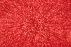 Rote Funkelnexplosion beleuchtet abstrakten Hintergrund Stockbild