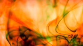 Rote gelbe und grüne Tinten-Tropfen des Wasser-Makro stock footage