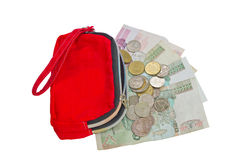 Rote Geldbörse mit Münzen und Banknote. Lizenzfreie Stockfotos