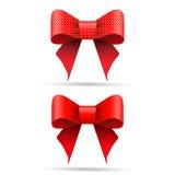 Rote Geschenkbögen Stockfoto