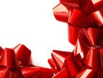Rote Geschenkbögen - Weihnachten Stockbild