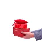 Rote Geschenkkästen der männlichen Handangebote Stockbild