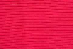 Rote gestrickte Wollebeschaffenheit Stockfotos
