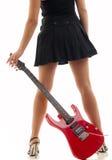 Rote Gitarre und schwarzer Minirock Stockbilder