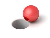 Rote glänzende Kugel vor Loch auf Weiß Lizenzfreie Stockbilder
