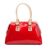 Rote glatte weibliche Lederhandtasche lokalisiert auf weißem Hintergrund Lizenzfreies Stockbild