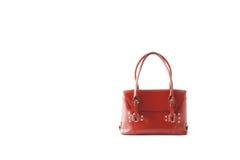 Rote glatte weibliche Ledertasche lokalisiert auf weißem Hintergrund Lizenzfreies Stockbild
