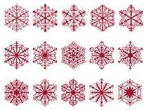 Rote glittery strukturierte Schneeflockendesigne lokalisiert auf Weiß Lizenzfreies Stockfoto