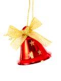 Rote Glocke mit dem goldenen Band erhellt stockfoto