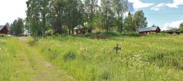 Rote Häuser in Norrbotten Stockfotografie