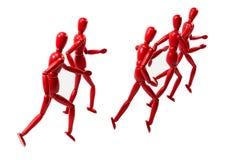 Rote hölzerne ART Modelle, die Gruppe laufen lassen Stockfotografie
