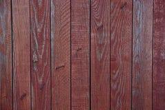Rote hölzerne Beschaffenheit einer alten Tür Stockfotos