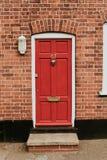Rote hölzerne Tür lizenzfreie stockfotos
