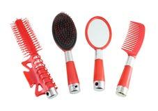 Rote Haarbürsten eingestellt Stockfotografie