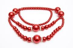 Rote Halskette Stockbilder