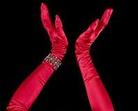Rote Handschuhe oben geworfen Stockfoto