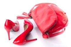 Rote Handtaschen- und Absatzschuhe Stockbilder