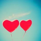 Rote Herz-förmige Ballone Stockbild