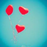 Rote Herz-förmige Ballone Lizenzfreie Stockbilder