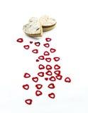 Rote Herzen und hölzerne Herzen Stockfotografie
