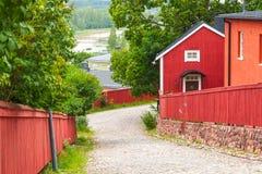 Rote hölzerne Häuser in Porvoo, Finnland Stockbilder