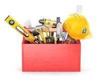 Rote Holzkiste voll Werkzeuge Stockfotografie