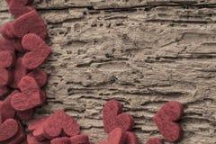 Rote Innere auf hölzernem Hintergrund Stockbilder