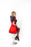 Rote Königin cosplay - recht junge Frau Stockbild