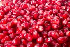 Rote Körner der Granatapfelnahaufnahme-Hintergrundbeschaffenheit stockbild