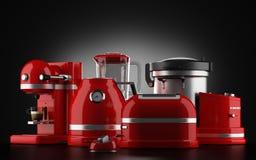Rote Küchengeräte auf Schwarzem Lizenzfreies Stockfoto