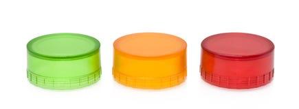 Rote Kappe des gelben Grüns Plastik Lizenzfreie Stockbilder