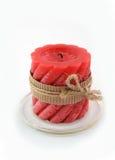 Rote Kerze auf dem weißen Hintergrund Stockfotografie