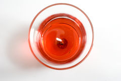 Rote Kerze im Glas Stockbild