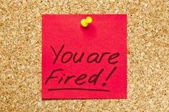 Rote klebrige Anmerkung ?Sie werden gefeuert!? Stockfotos