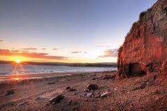 Rote Klippen bei Sonnenuntergang Stockfotografie