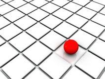 Rote Kugel unter weißen Quadraten Stockbild