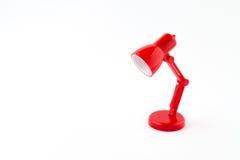 Rote Lampe auf Weiß Stockfoto