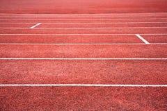 Rote laufende Spur Stockfoto