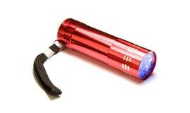 Rote Minitaschenlampe Stockbilder