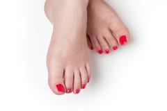 Rote Nägel nach Pediküre Lizenzfreie Stockfotos