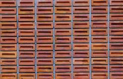 Rote oder orange quadratische Backsteinmauer, Blockbacksteinmauer-Beschaffenheit backgr Stockbild