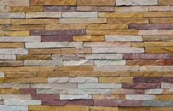 Rote oder orange quadratische Backsteinmauer, Blockbacksteinmauer-Beschaffenheit backgr Stockbilder