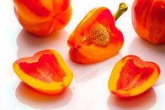 Rote Orange des Gemüsepfeffers auf Weiß Lizenzfreie Stockfotos