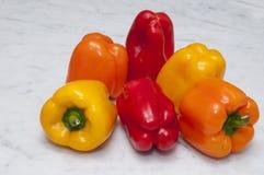 Rote orange und gelbe Pfeffer Lizenzfreie Stockfotografie