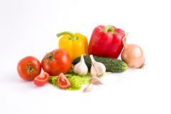 Rote Pfeffer und gelbe Pfeffer mit Tomaten auf einem weißen backgrou Lizenzfreies Stockbild