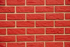 Rote Pseudo-ziegelstein Wand lizenzfreies stockfoto