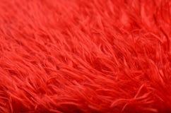 Rote Puppenhaarbeschaffenheit stockfoto