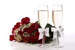 Rote Rosen und Champagne Stockfotos